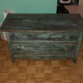 Teal antique dresser with glass knobs