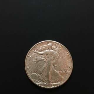 1942 Walking Liberty Silver Half Dollar (US$0.50)