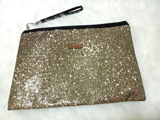 Gold Apostrophe clutch bag with free heart necklace