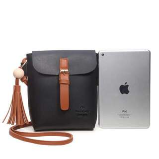 Black X brown sling bag