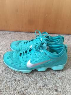 Turquoise Nike zoom shoes