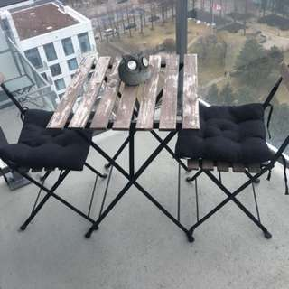 Black metal framed table with chairs