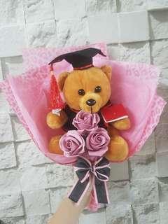 Graduation bear with rose bouquet