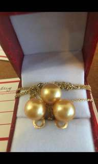 South sea pearls set deep golden quality.