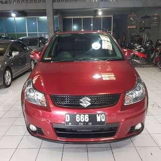 Suzuki sx4 xovet 2013 matic merah marun