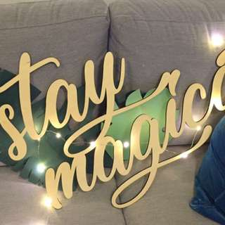 "Giant Wooden ""Stay magical"" signage"