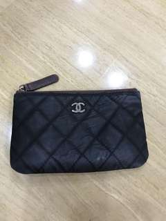 Well loved Chanel mini O case