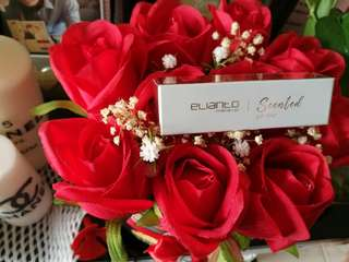 Gift box with romantic flowers
