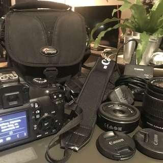 Canon D1100 EOS DSLR + 2 lenses