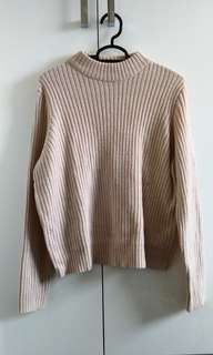 Knitted pastel pink sweater