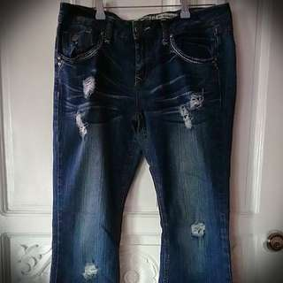Tattered Flared Jeans