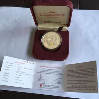 1998 Charity Work in Spore $5 Silver Proof Coin with Gold Insert