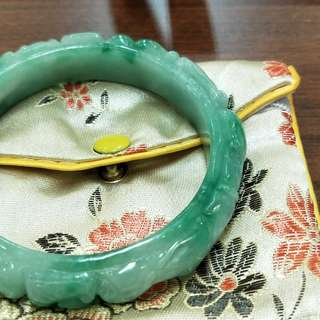 Jade bangle with carvings