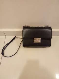 Charles and Keith Turnlock Clutch Bag