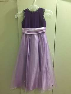 Purple gown with beads and bow