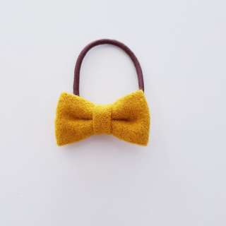 Tie band with bow