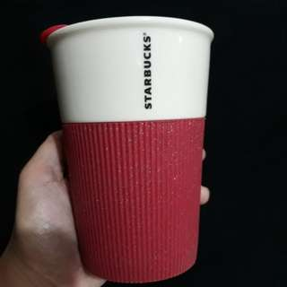 Starbucks coffee mug with lid and silicone sleeve