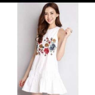 White dress with flower embroidery