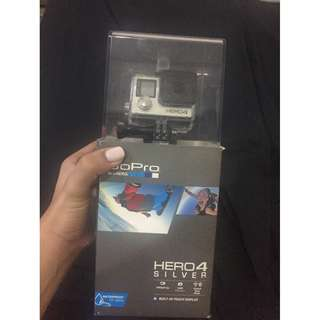 GOPRO HERO 4 (with battery packs and charger plus pole)
