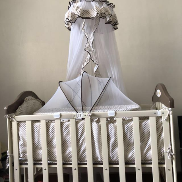 foldable metal crib with bassinet and mosquito net