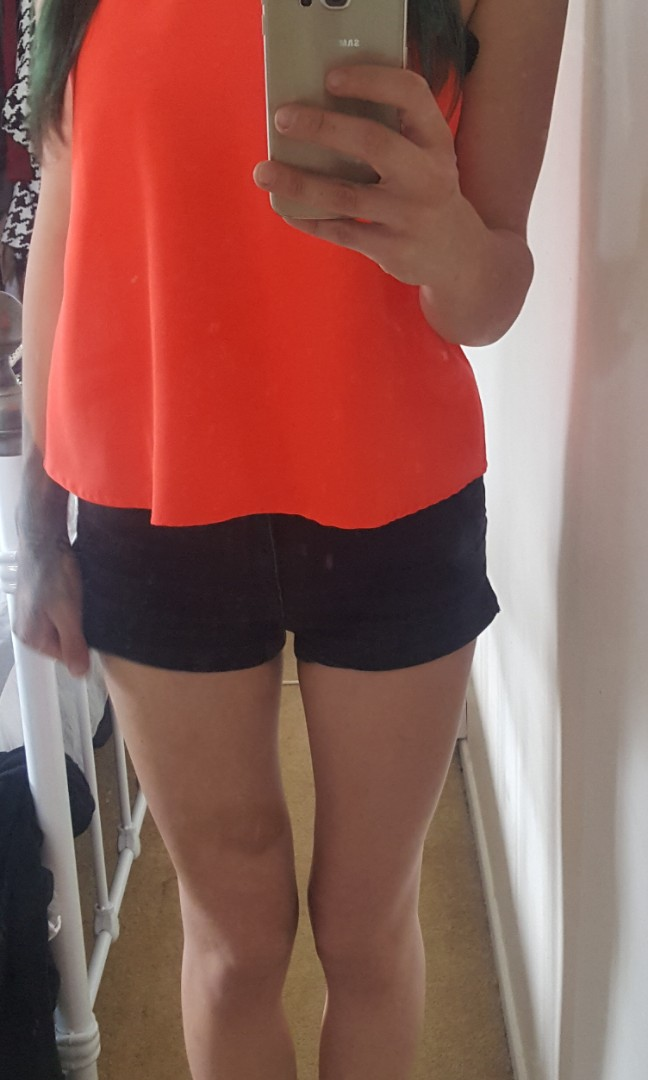Neon norts and crosses label top