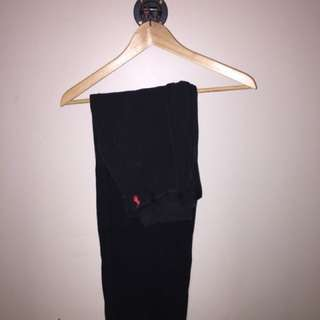 Black polo pants with red logo
