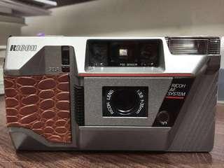 Vintage Ricoh film camera with custom skin