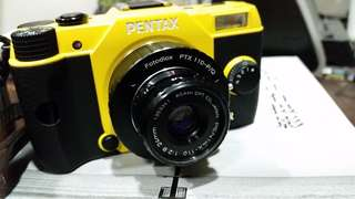 Pentax 110  24mm 2.8 (camera and book not included)