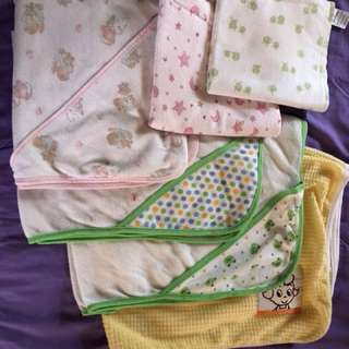 A package of 6 Baby Swaddles & towels