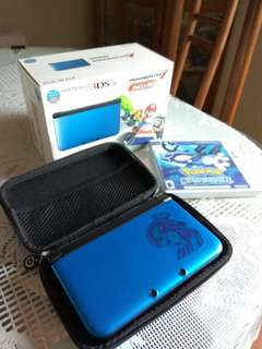 Nintendo 3DS XL with Pokemon Alpha Sapphire and Mariokart 7