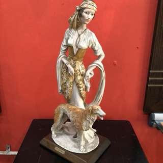 A Belcari Italy women with Dog sculpture
