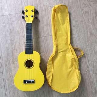 Bright yellow ukelele