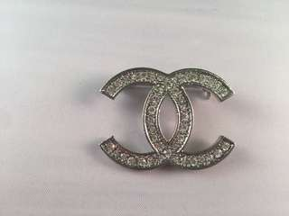 Authentic Chanel silver brooch for sale