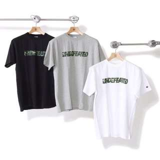 UNDEFEATED X CHAMPION MULTI CAMO UNDEFEATED S/S TEE