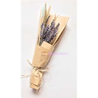 Dried flowers, lavender bouquet in brown kraft wrapping paper