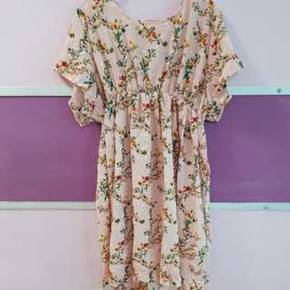 Brand new beautiful dress with ribbon behind.