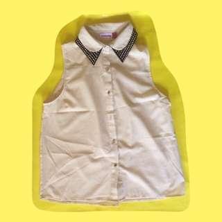 flesh sleeveless botton down with studded collar