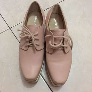Soft pink platform shoes