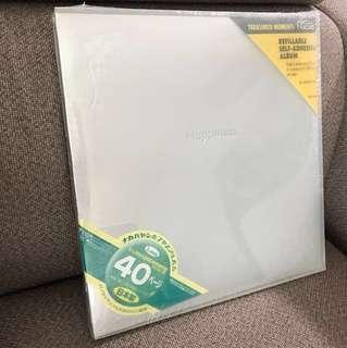 Self adhesive album