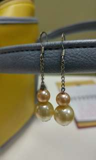 Faux pearl dangling earrings