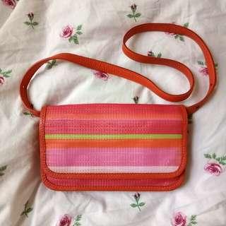 Bright orange and pink purse
