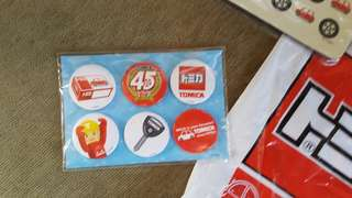 Tomica mouse pad and commemorative pins