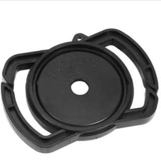 Camera lens cap buckle holder keeper