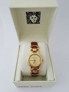 Anne Klein Women's Gold Tone Brown Leather Bracelet Watch