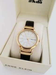 Anne Klein Women's Gold Tone Brown Leather Bracelet Watch,