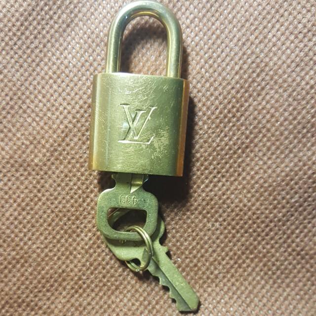 b21e08f64f51 Authentic Louis Vuitton PADLOCK   KEY SET