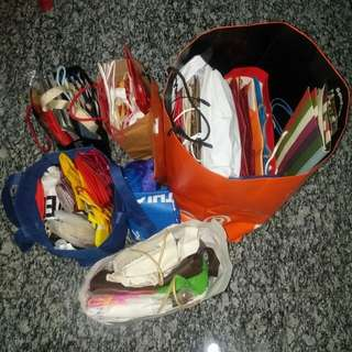 At least 10000 pcs of paper bags plastic bags (assorted)