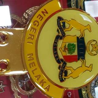 Melaka gold white car badge emblem