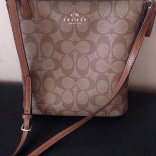 Authentic Coach sling bag from us..