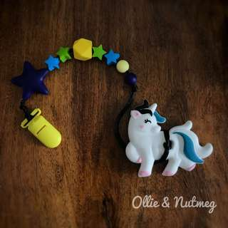 Customised teething pacifier clip with teether